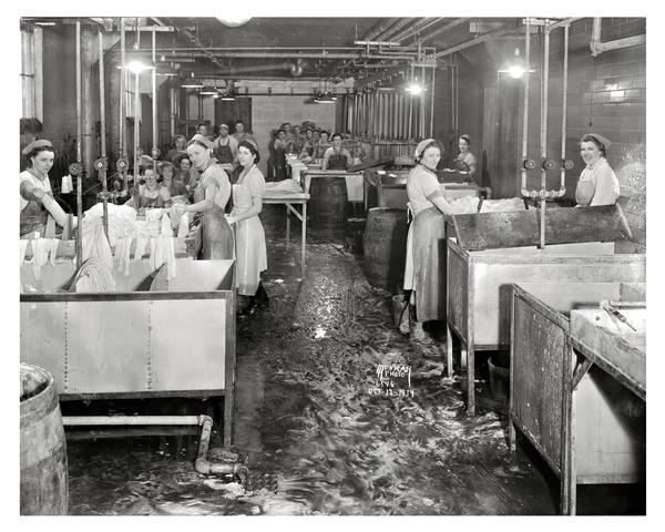 Women working in casing department at the Oscar Mayer & Company meat packing plant, 910 Mayer Avenue.