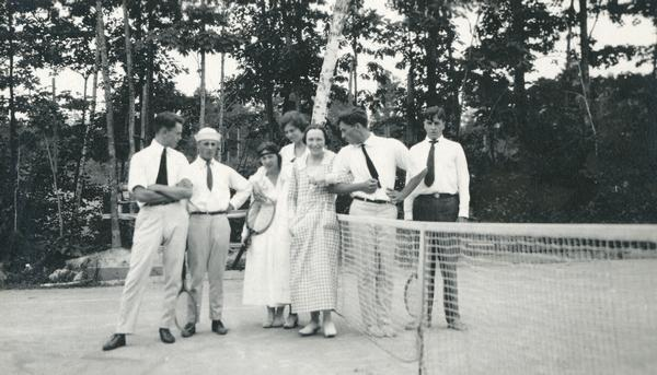 Four men and three women posing on Hull's tennis court.