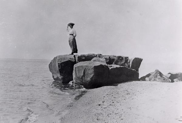 Woman standing on soldier's rock on Madeline Island.