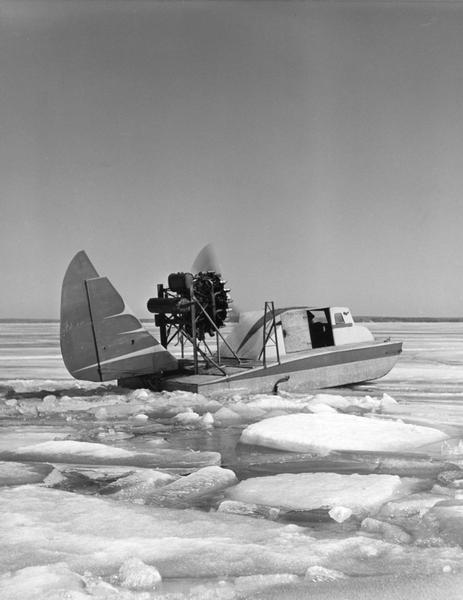 "This was the first boat & sled-type windsled built on Madeline Island. Built by Elmer Nelson for Howard Russell between 1950-1951. Had a 9-cylinder R-680-E3 Lycoming engine. The tail was a portion of a Stinson AT-19 airplane. Overall length of the windsled was 23'6"" and 7'10"" wide with a carrying capacity of 6-7 persons. This windsled was operated from 1951-1957 between Bayfield and Madeline Island."