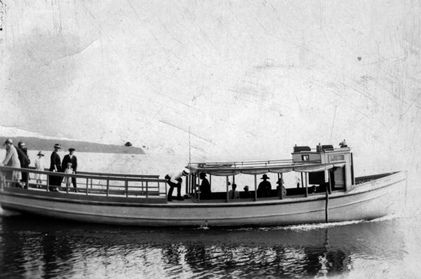 "Group of people on board the steamboat ""Byng I"" sometime prior to 1930."