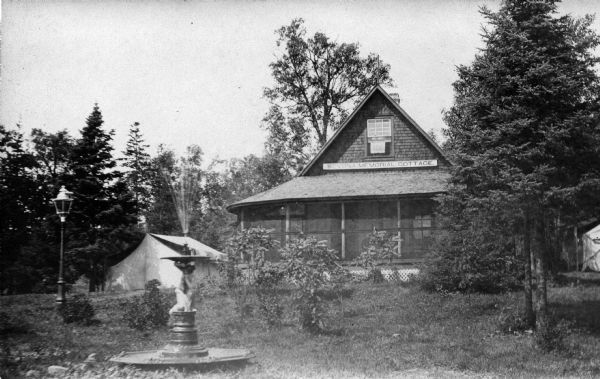 "House, ""Camp Stella,"" a.k.a. ""Sevona Memorial Cottage,"" on Sand Island. The structure was orignally built by Sam S. Fifield, ex-Lieutenant Governor of Wisconsin, from salvaged materials of the ""Sevona,"" a steamboat that wrecked off the shore of Sand Island in 1905."