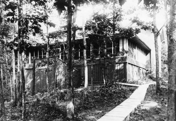 Outside view of the Hull Cottage porch, including the boardwalk leading from the lake.