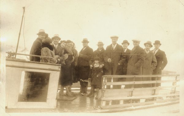 Group of people standing on board a passenger ferry bound for a New Year's trip to Ashland.