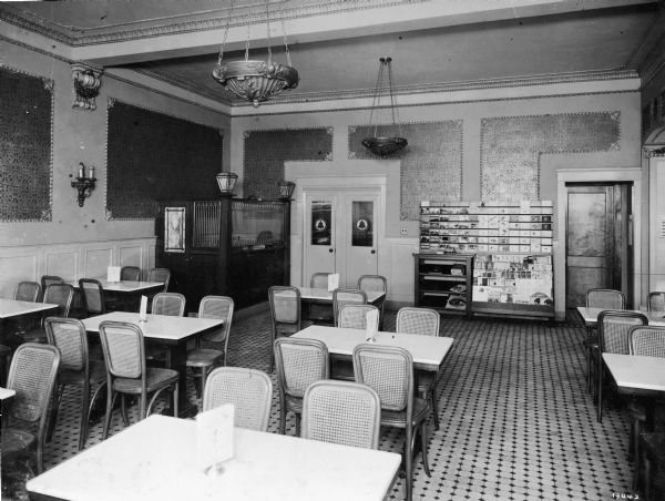 Interior view of the modern grill room and postal station in the Baldauf Drug Company.