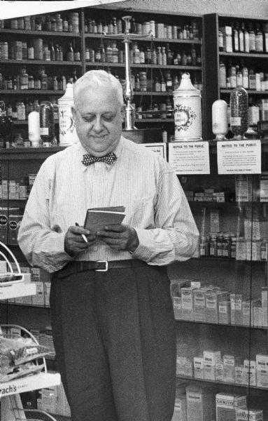Edward Farber, a prominent Milwaukee druggist, double checks a prescription order on the day before he retired. Farber operated his popular drugstore, located at 4217 W. North Avenue, for 43 years.