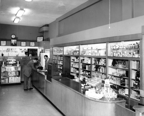 A customer pays for his medication at the Lascoff Pharmacy.