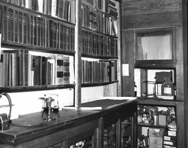 View showing part of the pharmacist's working library at D.F. Jones' Pharmacy.
