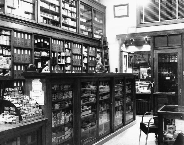 View of the interior of D.F. Jones' Pharmacy, showing an assortment of shelving compartments for items in the store.