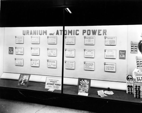Display in the window of a pharmacy, explaining what happens to uranium as atomic power is produced.
