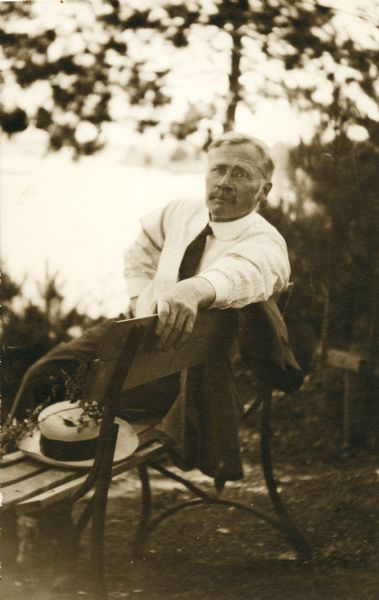 Notable University of Wisconsin pharmacist Edward Kremers relaxes on a bench in a park near the time of the Wisconsin Pharmacy State Convention in 1916.