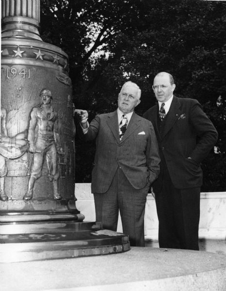 Robert Fischelis and H.A.B. Dunning examine the War Memorial at the American Pharmaceutical Association Headquarters building.
