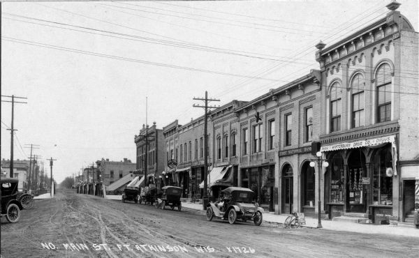 View of businesses located on north Main Street, including Winterburn Drugs and the First National Bank.