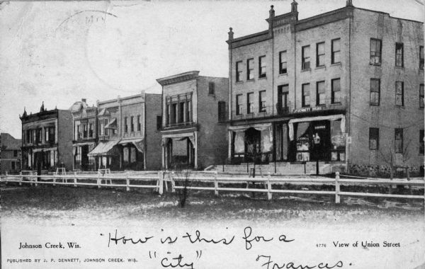 View of the businesses on Union Street, notably J.P. Dennett's Drug Store, located on the far right corner.