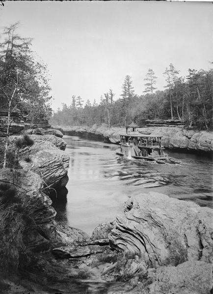 "Clam Banks; upstream from Arm Chair with steamboat passing, (probably the ""New Dell Queen"")."