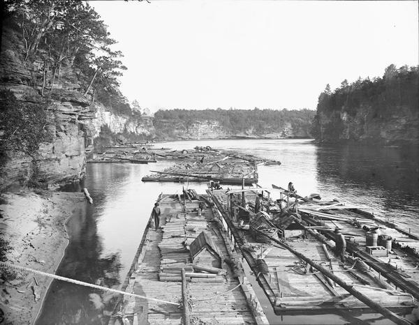 A fleet of rafts on the Wisconsin River below the Kilbourn dam.