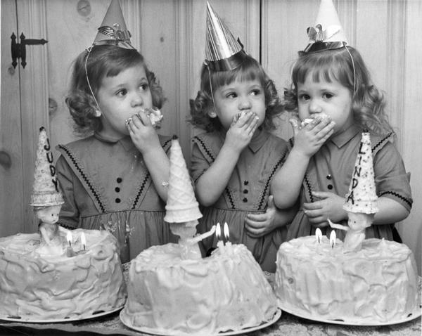 Second birthday party of Judy, Robin, and Linda Constantineau of 8106 W. Euclid Ave. All three girls are eating cake.
