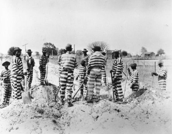 African American prison inmates working on a road chain-gang in Florida or Georgia.