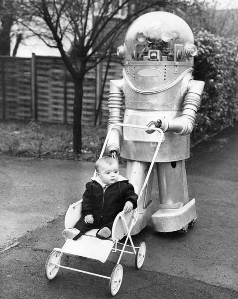 An infant being pushed in a baby flyer (baby carriage) by a robot in Leeds, England.