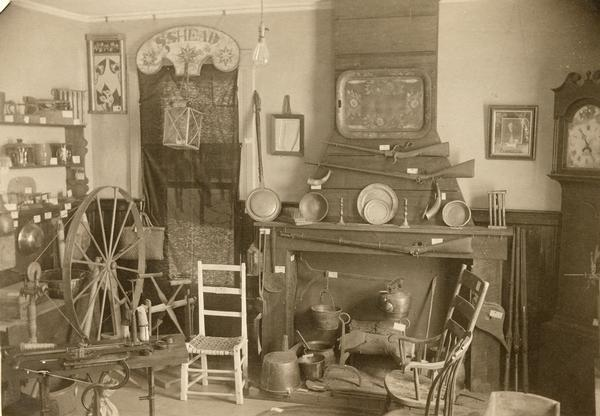 A collection of pioneer household articles arranged in a living room.