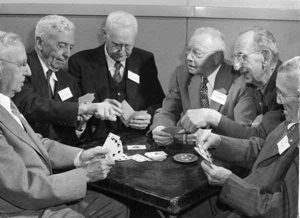 Members of a musician's union play cards together.