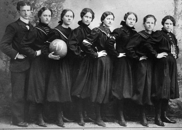 Women's basketball team poses for a group portrait.
