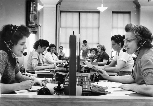 Female telephone operators busy at work.