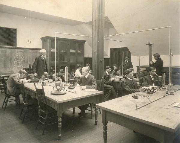 Students and teacher in physics lab at Stevens Point Normal School, which would later become the University of Wisconsin-Stevens Point.