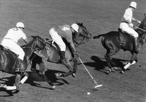 Elevated view of a polo game in action.