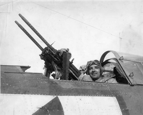 Marine Captain Joseph R. McCarthy, later a Wisconsin senator, posing as a tail gunner during World War II in Douglas SBD Bomber. McCarthy was an intelligence officer and he flew along as an observer on several bombing missions. McCarthy spent 16 months in the Solomon Islands, serving two tours from September 1943 to March 1944. He returned to the United States in July 1944, assigned to various California military bases. McCarthy resigned from the Marines on December 11, 1944.