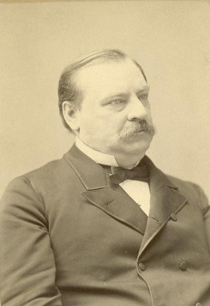 Waist-up portrait of Grover Cleveland.