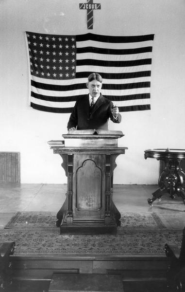 Preacher Chas V. Reed delivering a sermon on tuberculosis in conjunction with an International Harvester Agricultural Extension Department lecture. Mr. Reed was the preacher at Big Woods Congregational Church near Eola.
