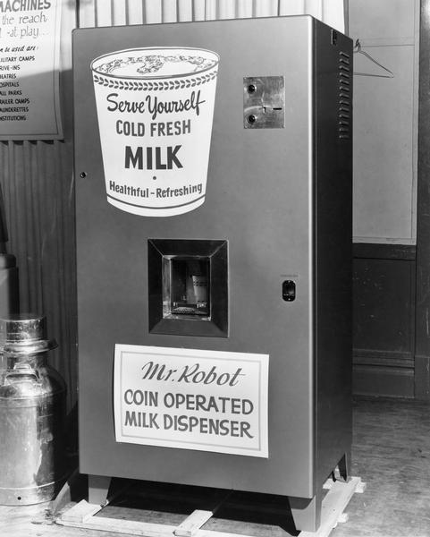 Mr. Robot, a coin operated milk vending machine promoted by the Wisconsin Dairy Caravan, dispenses milk into a paper cup.
