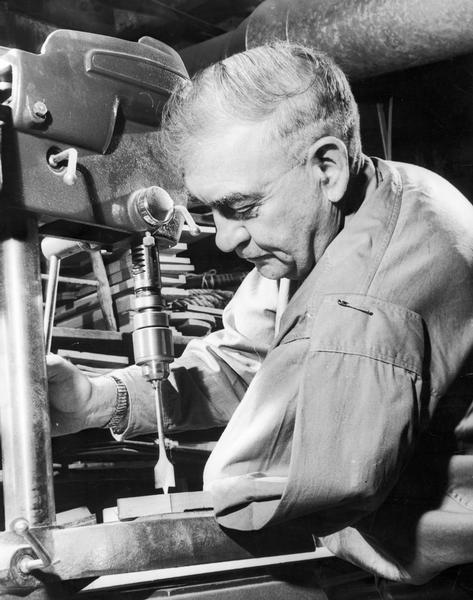 Elmer J. Schmidt makes furniture and toys in his woodshop even though he has only one arm to work with.