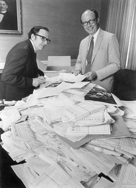 """Christian Herald"" editor Kenneth L. Wilson, left, and publisher, Fen Loomer look through some of the over 25,000 pieces of mail with over 160,000 signatures supporting the magazine's protest against sex and violence on television."