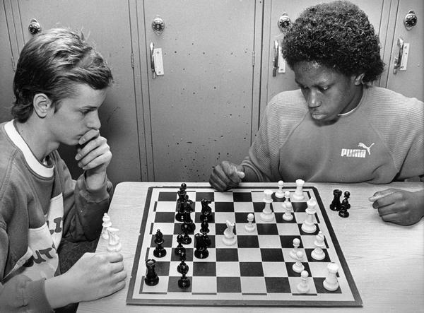 Calvin Johnson, right, Custer High School chess champion, takes on Paul Henk to defend his title.