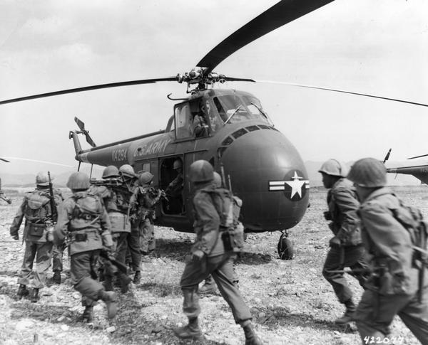 Infantry troops board helicopters for Korea via the 6th Transportation Helicopter Company, the first Army cargo helicopter unit in the combat zone. The 6th was called up in November 1952 and arrived in Korea with their H-19C helicopters in January, 1953.  The armistice was signed, several months later, on July 27.  For Joseph R. McCarthy and the conservative Republicans the ceasefire meant that there were be no victory over Communism in Korea.