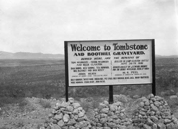 Sign welcoming visitors to Tombstone, Arizona and the cemetery where members of the Clanton gang that were killed in the Earp-Clanton battle September 26, 1881 are interred.