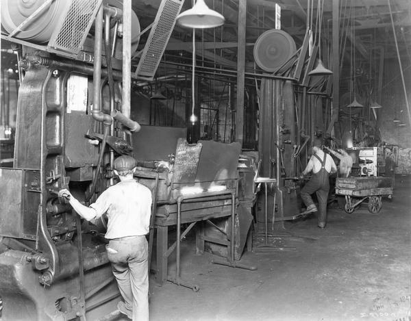 Men operating large machines at International Harvester's Springfield Works. The factory produced trucks.