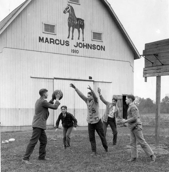 Boys practicing for winter basketball games on the farm of Marcus Johnson.