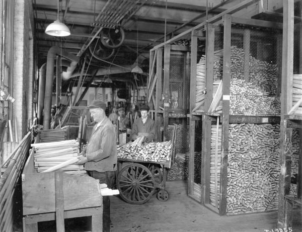Workers handling spokes for wagon wheels at International Harvester's Weber Wagon Works. The factory was located at Auburn Park and was owned by the Weber Wagon Company until 1904. International Harvester continued to produce wagons at the factory until 1927.