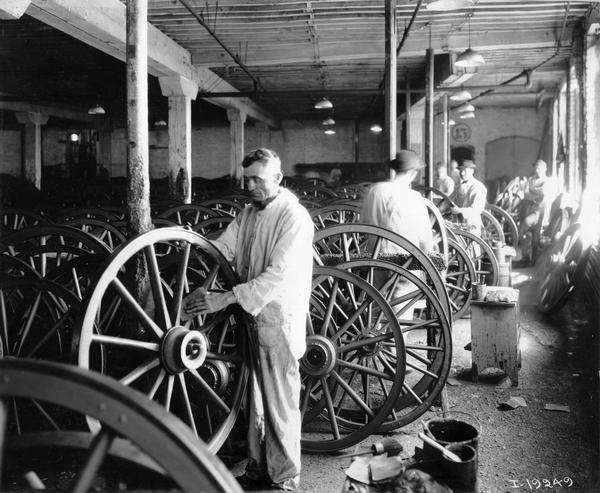 Workers sanding wagon wheels at International Harvester's Weber Wagon Works in Auburn Park. The factory was owned by the Weber Wagon Company until 1904, when it was purchased by International Harvester.