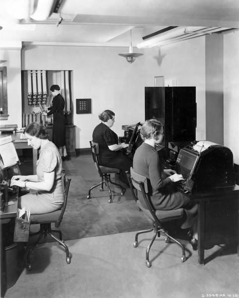 Female employees inside the teletype room at International Harvester's general office.