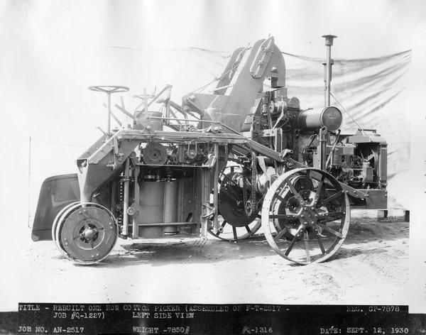 "Engineering photograph of a ""rebuilt"" experimental one row cotton picker (""assembled on F-T-2517"")."
