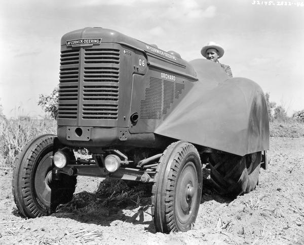 W.A. Gearhart operating a McCormick-Deering O-6 orchard tractor and disc harrow.