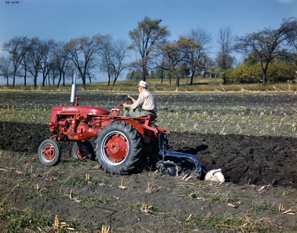 Farmall Tractor Plows : Plowing with mccormick farmall super a tractor