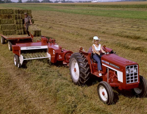 Black White An D Tractor Pulling Wagon : Baling hay with international tractor and baler