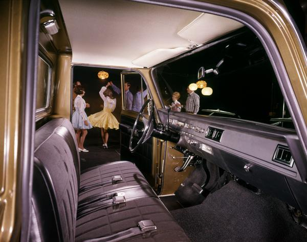 Color advertising photograph of men and women square dancing as viewed through the cab of an International pickup.