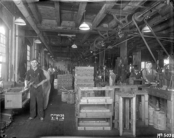 "Workers making wooden boxes inside a wood shop at International Harvester's McCormick Works. The McCormick works was built in 1873 by Cyrus McCormick and became part of International Harvester in 1902. The factory was located at Blue Island and Western Avenues in the Chicago subdivision called ""Canalport.""  It was closed in 1961."