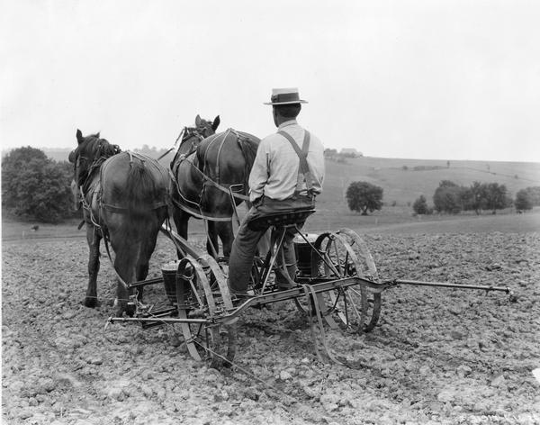 Farmer In Field With Horse Drawn Corn Planter Photograph